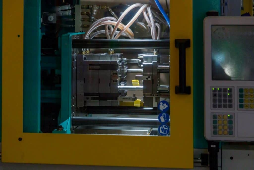 Process of forming bricks Lego using the plastic injection molding machine in Legoland